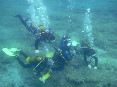 Sailing Greek islands - Greece charter sailing holidays - Andrei and his friend scuba diving