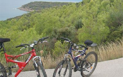 Sailing Greek islands - Greece charter sailing holidays - Riding the bycicle in the islands