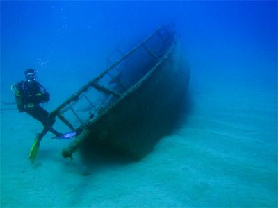 Sailing Greek islands - Greece charter sailing holidays - Scuba Diving - Diver near ShipWreck