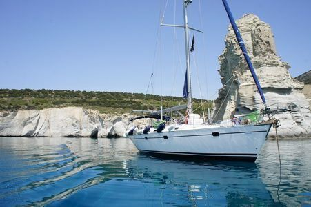 Sailing Greek islands - Greece charter sailing holidays - sailboat achored amazing waters