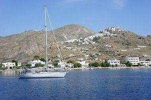 Sailing Greek islands - Greece charter sailing holidays - Sailboat anchored near stiff wall