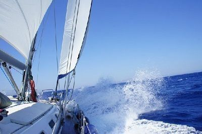 Sailing Greek islands - Greece charter sailing holidays - autumn Sailing - Dolphins playing near sailboat