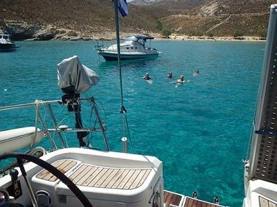 Sailing Greek islands - Greece charter sailing holidays - Swimming in turquoise waters from sailboat