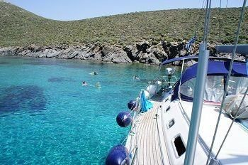 Swimming in turquoise waters from sailboat