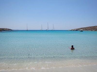 wonderful swim spot with beautiful water sailboats anchored